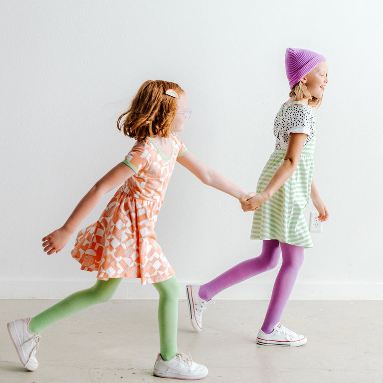 TIGHTS SHOWN ON CHILDREN WALKING AND TALKING WHILE HOLDING HANDS