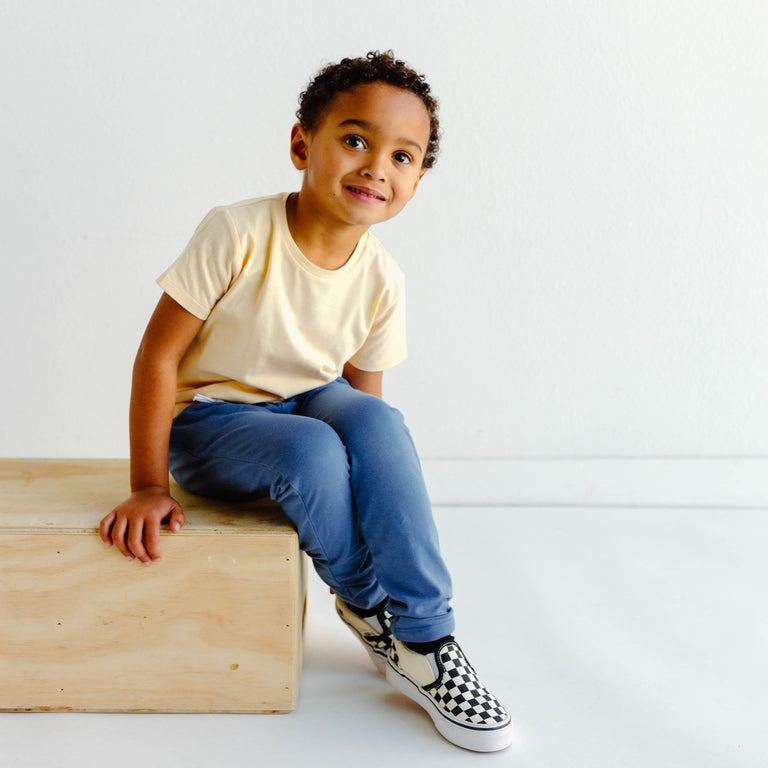 CHILD SHOWN WEARING OAT BASIC TEE