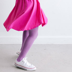VIOLET KNIT TIGHTS SHOWN ON CHILD SPINNING WITH TWIRLING DRESS