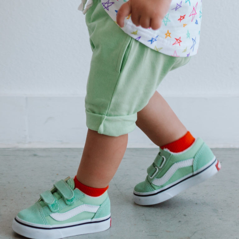 POPPY SHORT SOCKS SHOWN ON CHILD PAIRED WITH LIGHT GREEN SHOES AND MATCHING SHORTS