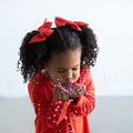 Thumbnail for poppy everyday bow shown as a set on a little girl blowing confetti from her hands towards the camera