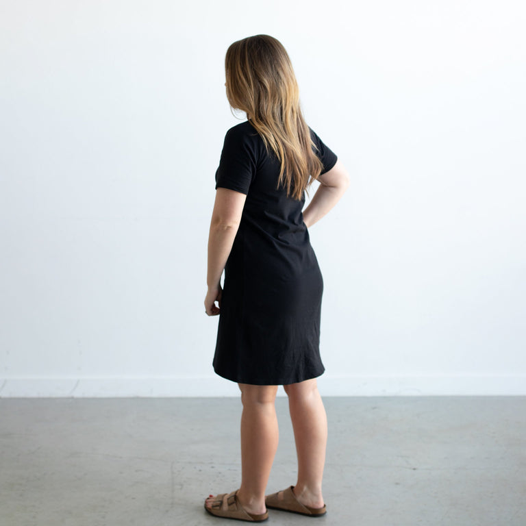 ONYX GROWN UP TEE DRESS ON A WOMAN FACING AWAY FROM THE CAMERA