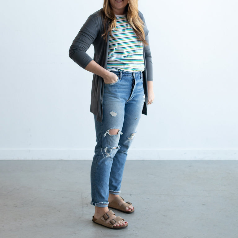 Charcoal Grown Up Cardigan on a woman wearing Ringer Tee, Jeans, and Sandals with her hand in her pocket