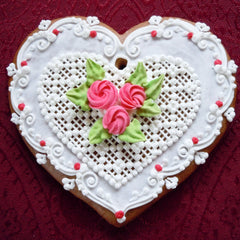 Gingerbread heart with lacy pattern and roses
