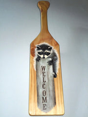 Welcome sign on a wooden paddle - Raccoon