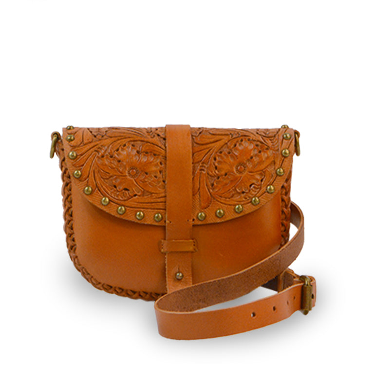 Tooled leather crossbody bag on mannequin, Cassie Convertible Crossbody Bag.