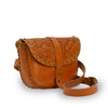 Tooled leather crossbody bag at an angle, Cassie Convertible Crossbody Bag.