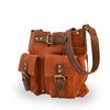 Brick colored suede crossbody bag at an angle, Joan Suede Crosbody Bag.
