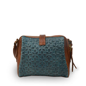 Backside of blue quilted leather crossbody bag, Sam Quilted Crossbody Bag.