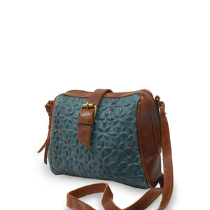 Blue quilted leather crossbody bag at an angle, Sam Quilted Crossbody Bag.