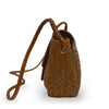Side of brown woven leather bag with smooth flap, Sawyer Woven Shoulder Bag.
