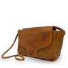 Brown woven leather bag with smooth flap at an angle, Sawyer Woven Shoulder Bag.