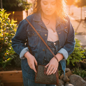 Woman wearing a green quilted crossbody bag, Sam Quilted Crossbody Bag.