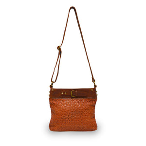 front view of rust leather quilted bag with the handle up, Joan Quilted Crossbody Bag.