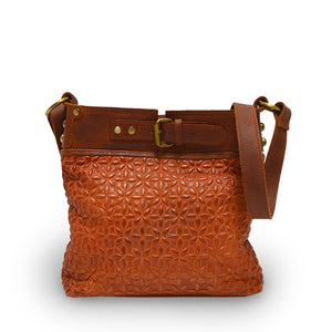 front view of rust leather quilted bag with the handle down, Joan Quilted Crossbody Bag.