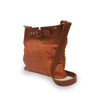 angle view of rust leather quilted bag with the handle down, Joan Quilted Crossbody Bag.