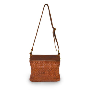 back view of rust leather quilted bag with the handle up, Joan Quilted Crossbody Bag.