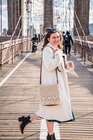 Model wearing Lani crossbody bag in cream color.