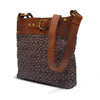 Angle view of brown quilted leather bag, Joan Quilted Crossbody Bag.