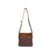 Front view of brown quilted bag with handle up, Joan Quilted Crossbody Bag.