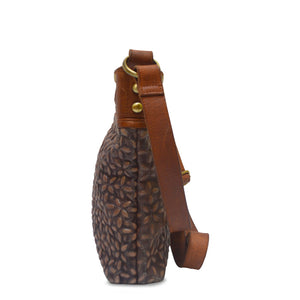 Side view of brown quilted leather bag, Joan Quilted Crossbody Bag.