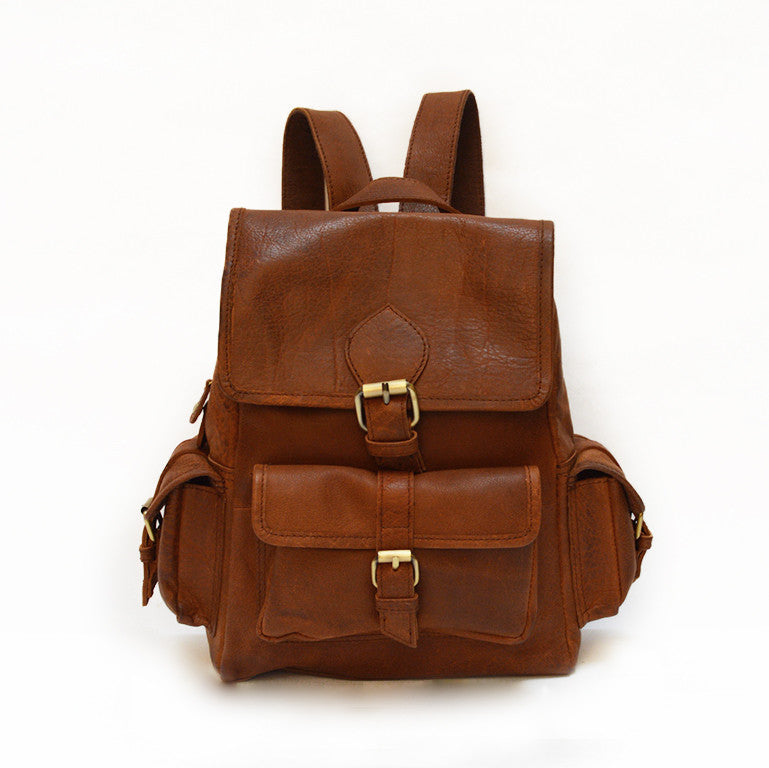 Small brown leather backpack, front view, adjustable straps, Sadie Leather Backpack.