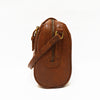 Side view of the bag, handle down, brown leather, Sam Leather Crossbody Bag.