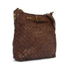 Bag at an angle, handle down, brown leather, Joan Woven Leather Crossbody Bag.