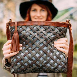 women holding leather crossbody bag outside, embroidery, Aaralyn Crossbody Bag.