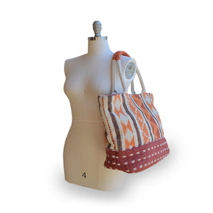 Orange fabric tote on mannequin, Cara Fabric Tote.
