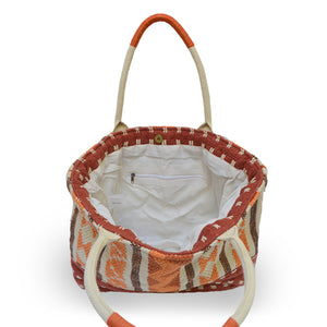 Interior view of an orange fabric tote, Cara Fabric Tote.