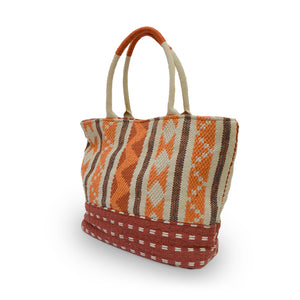 Angle view of an orange fabric tote, Cara Fabric Tote.