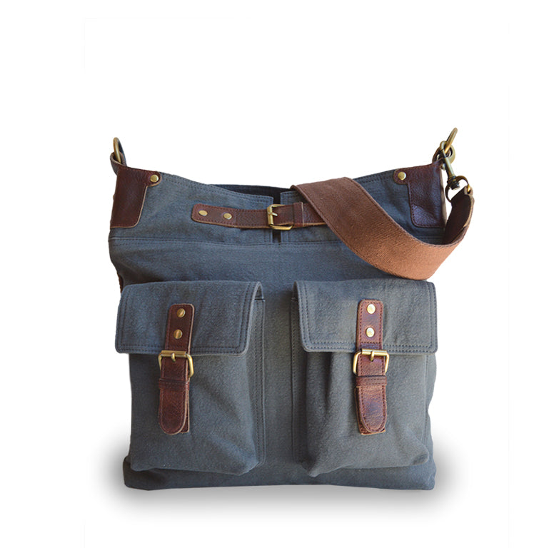 Front view of a gray-blue canvas crossbody bag with handle up, Daily Crossbody Bag.