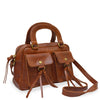 Brown leather bag with two pockets and a handle at an angle, Dora Crossbody Bag.