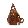 Side of brown leather bag with two pockets and a handle, Dora Crossbody Bag.