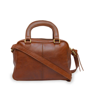 Back of brown leather bag with two pockets and a handle, Dora Crossbody Bag.