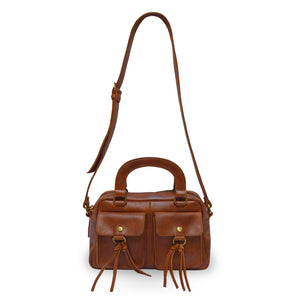 Brown leather bag with two pockets and has both a handle and a strap, Dora Crossbody Bag.