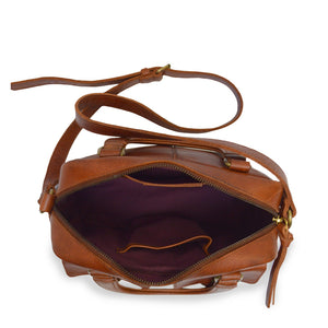 Interior of brown leather bag with two pockets and a handle, Dora Crossbody Bag.