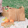 closeup of picnic food items and a leather tote, Grace Shoulder Bag.