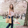woman in front of cherry blossoms at waterfront park in portland, oregon with a purse, Grace Shoulder Bag.