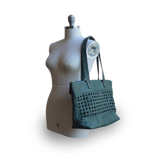 open weave green leather tote on mannequin, Haddie Woven Tote.