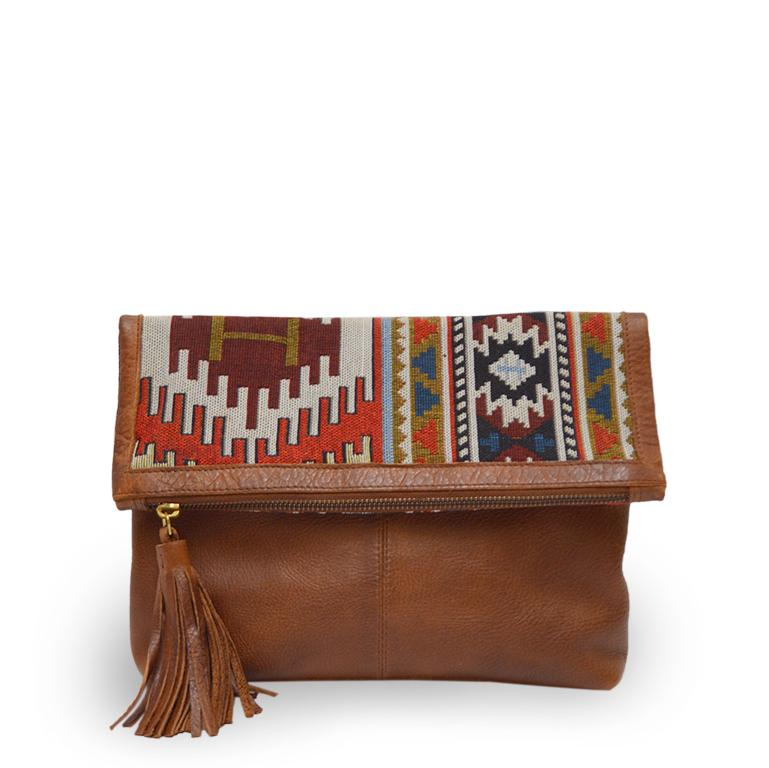 Small leather clutch with a jacquard flap, bag at an angle, Idina Jacquard Clutch.