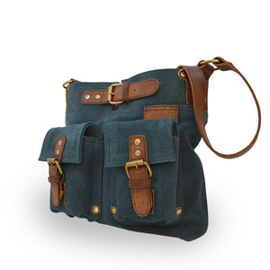 Teal suede crossbody bag at an angle, Joan Suede Crossbody Bag.