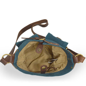 Interior view of teal colored suede crossbody bag, Joan Suede Crosbody Bag.