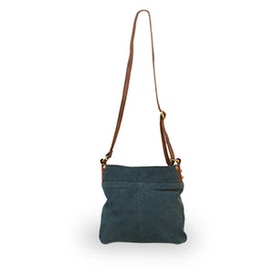 Back of teal suede crossbody bag, Joan Suede Crossbody Bag.