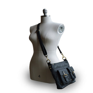 Bag on mannequin, black leather, Joan Leather Crossbody Bag.