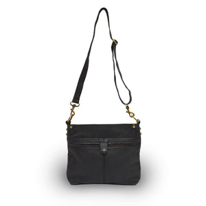 Back view of bag, handle up, black leather, Joan Leather Crossbody Bag.
