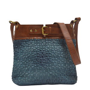 Front view of blue quilted leather bag, Joan Quilted Crossbody Bag.