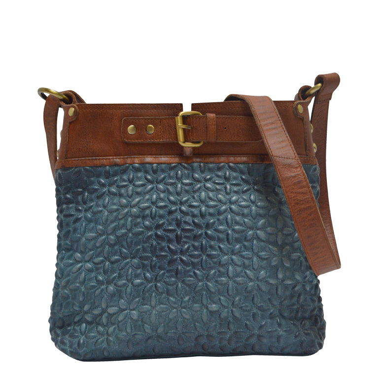 9b5e24a41fe0 Front view of blue quilted leather bag, Joan Quilted Crossbody Bag.