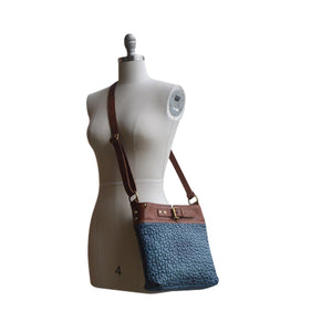 Blue quilted leather bag on mannequin, Joan Quilted Crossbody Bag.